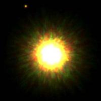 Небольшое пятно в верхней левой части изображение может быть планетой, вращающейся вокруг звезды, похожей на Солнце (изображение с сайта ScienceNews)